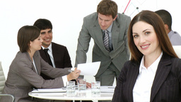 Smiling businesswoman with her team in the backgro Footage