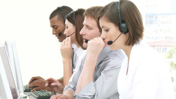 Multiethnic people working in a call center Footage