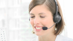 Close up of smiling woman working in a call center Footage