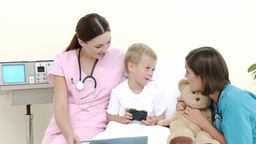 Little patient talking to a nurse and a pediatrici Footage
