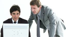 Two young Businessmen working together in an offic Footage