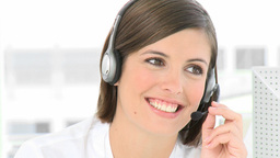 Businesswoman talking on a headset in the office Stock Video Footage