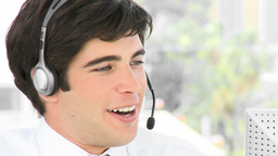 Young businessman talking on a headset Stock Video Footage