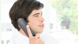 Young businessman talking on the phone Stock Video Footage