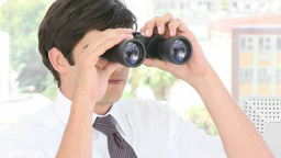 Young Businessman looking through binoculars Stock Video Footage