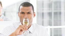 Businessman with a glass of Champagne Stock Video Footage