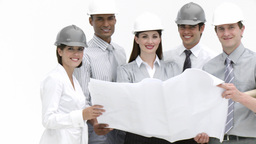 Construction workers looking at a drawing in a bui Stock Video Footage