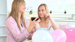 Delighted female friends playing with a digital ca Footage