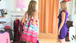 Charming women trying dresses together Stock Video Footage