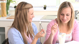 Beautiful female friends eating ice cream Stock Video Footage