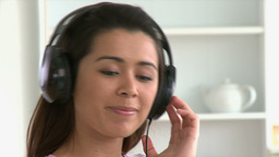 Cheerful asian woman listen to music wearing headp Footage