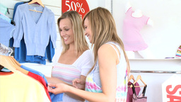 Positive young women are doing shopping Stock Video Footage