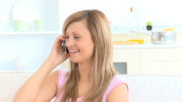 Beautiful young woman talking on phone Stock Video Footage