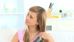 Elegant Young Woman Combing Her Hair stock footage