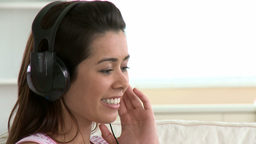 Cheerful asian woman listen to music Footage