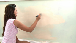 Young asian woman painting a room Stock Video Footage