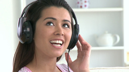 Singing asian woman listen to music Footage