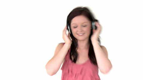 Radiant young woman listen to music wearing headph Stock Video Footage