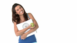 Healthy asian woman holding scales and apple Footage