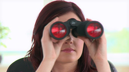 Young businesswoman using binoculars Stock Video Footage