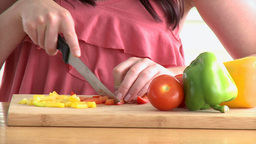 Pretty young woman cutting vegetables Stock Video Footage