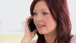 Animated caucasian woman talking on phone Footage