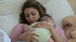 Caring young mother with her beautiful baby on a s Footage