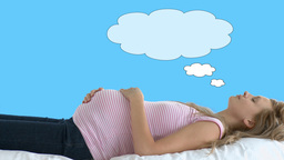 Pregnant lying on the floor with cloud above her h Footage