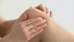 Close up of a woman with knee pain Stock Video Footage