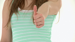 Close Up Of A Teenager Doing A Thumbs Up stock footage