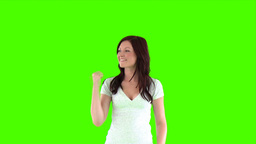 woman doing a thumbs up against a green screen Footage