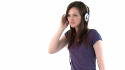 smiling woman listening to the music with headset  Footage