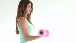 Cute woman doing exercises with dumbbells Footage