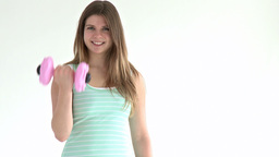 smiling girl holding dumbbells looking at the came Stock Video Footage