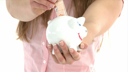 Close up of a girl showing a piggybank Footage