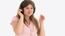 concentrated girl listening music with headset on Footage