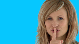 Fascinating woman doing shh sign Footage