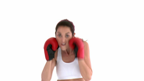Hispanic woman wearing boxing gloves Footage