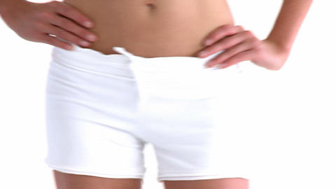 Close up of the hips of a hispanic woman posing in Footage
