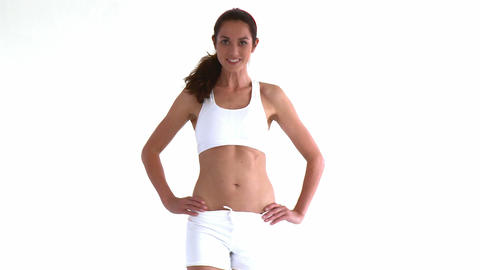 Sporty hispanic woman posing in front of the camer Stock Video Footage