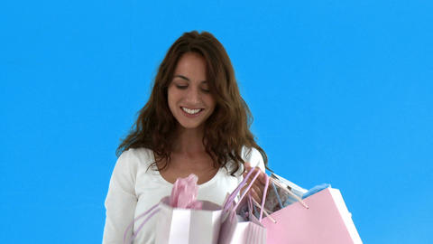 Cheerful hispanic woman holding shopping bags Stock Video Footage