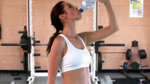 Athletic woman drinking water Footage