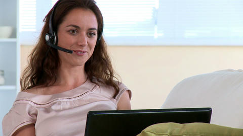 Smiling woman having talk by means of computer Footage