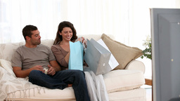 Man watching television when his wife comes home a Footage