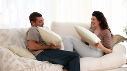 Man and woman doing a cushion figh Stock Video Footage
