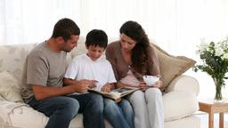 Family reading on sofa Footage