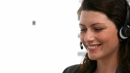 Woman talking on the headphone Footage