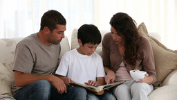 Family reading on the sofa Footage