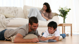 Father doing homework with his son Live Action