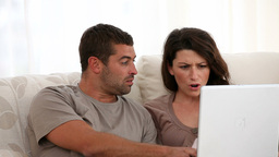 Couple watching a video on the laptop Live Action